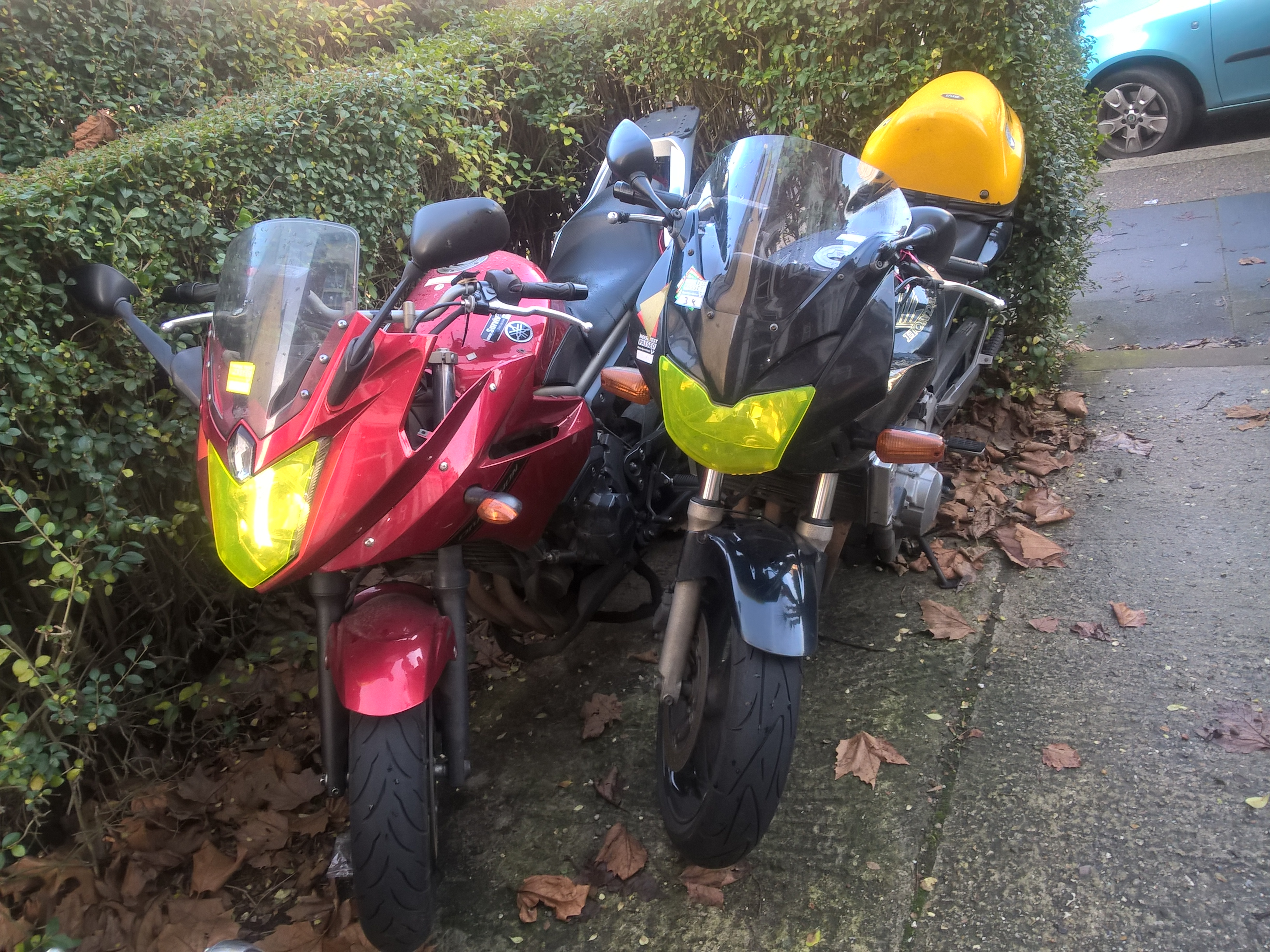 Motorcycles with headlight covers